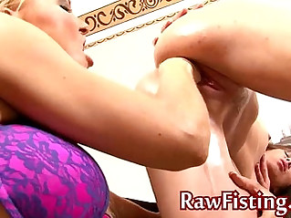 Fisting wet lesbian pussy