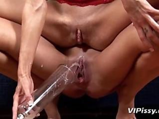 Lesbian brunette gets her first taste of piss